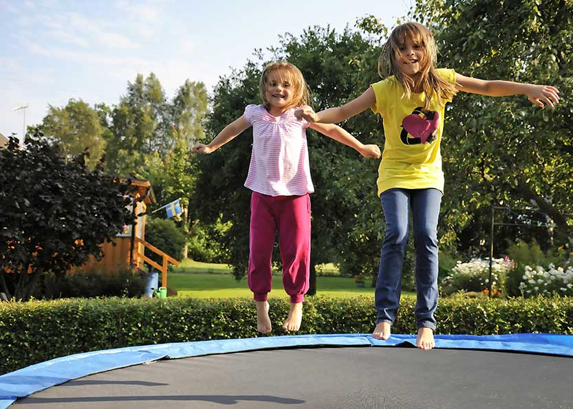 Children On Trampoline Back Yard