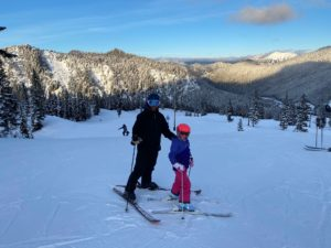 Nick skiing with daughter